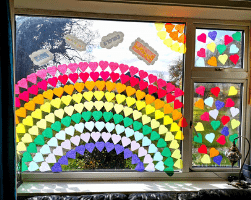 fun coloured window with hearts